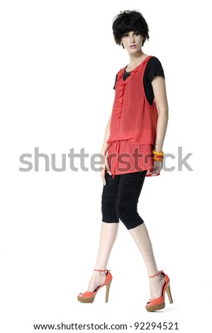 Full-frame portrait of a model practicing catwalk - stock photo