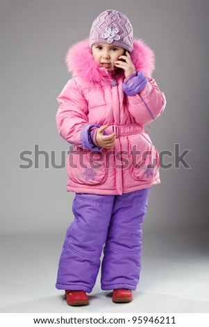 Full-frame pretty little girl with phone - stock photo