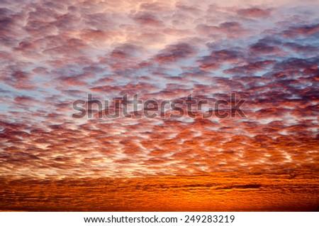 Full Frame Scenic of Dramatic Sky with Clouds Diminishing Toward Horizon at Sunset - stock photo
