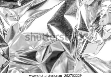 Full frame take of a sheeT of crumpled aluminum foil - stock photo