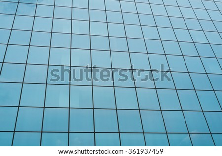 Full frame take of the mirrored facade of a corporate building