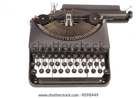 Full frontal view of vintage portable manual typewriter with paper carriage to the right.