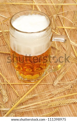 Full glass of beer on barley straw