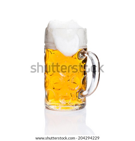 Full glass of beer on isolated background - stock photo