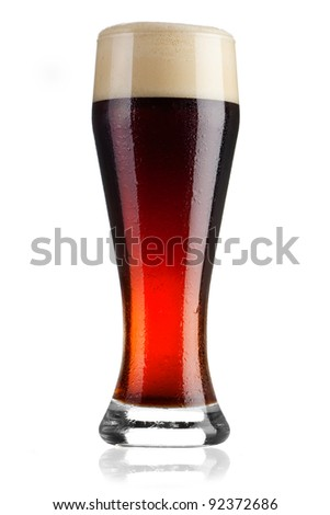 Full glass of cold dark beer on white background - stock photo