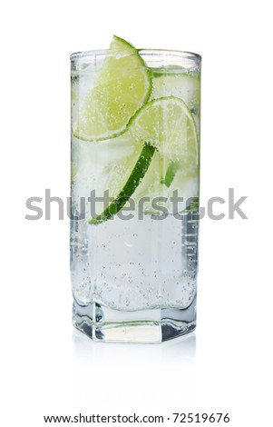 Full glass of fresh cool tonic with lime fruits isolated on white background - stock photo