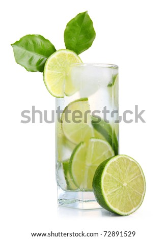 Full glass of fresh cool tonic with lime fruits isolated on white background