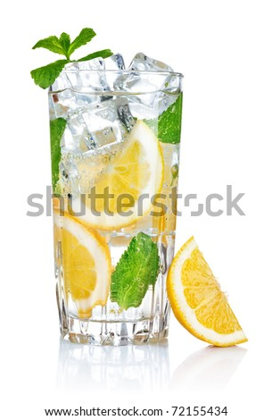 full glass of fresh cool transparent water with lemon and mint leaves - stock photo