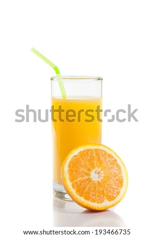 full glass of orange juice with straw near half orange on white background