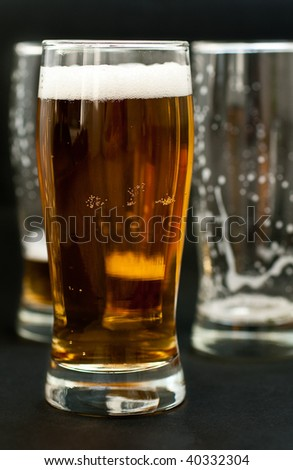 Full glass with cold beer