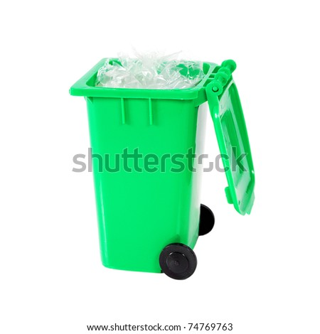 full green recycling bin with plastic - stock photo