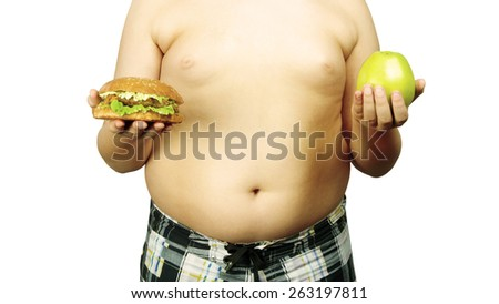 full guy holding a hamburger and an apple - stock photo