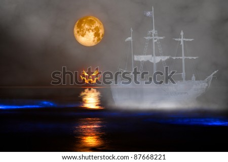 Full Harvest Moon, Jack-o-Lantern, Ghost Pirate Ship & Sea Glowing with Sinister Bio-luminescence Red Tide Waves - stock photo