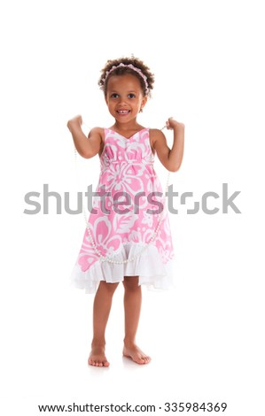 Full height mulatto smiling young girl with curly hair. Happy childhood - stock photo