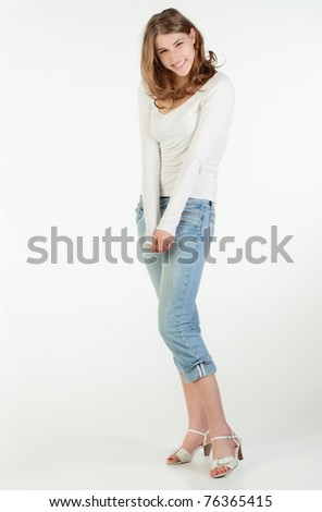 Full height portrait of a shy teenager girl