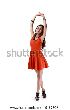 Full height portrait of relaxing young asian woman hand up stretching herself, Isolated over white with clipping path - stock photo