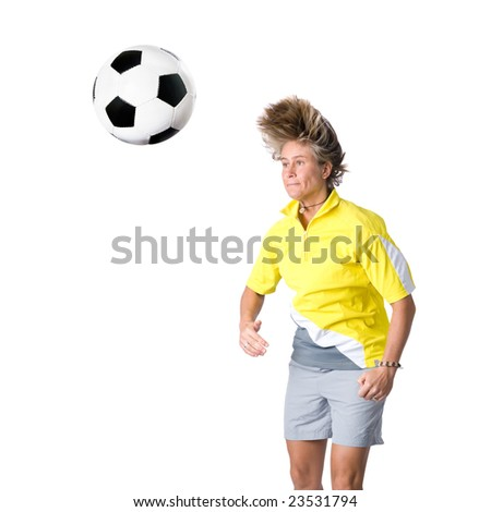 Full isolated picture of a  caucasian woman playing soccer
