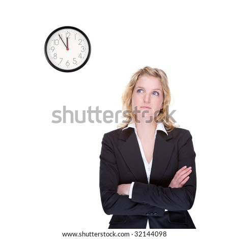 Full isolated portrait of a beautiful caucasian businesswoman locking at the clock - stock photo