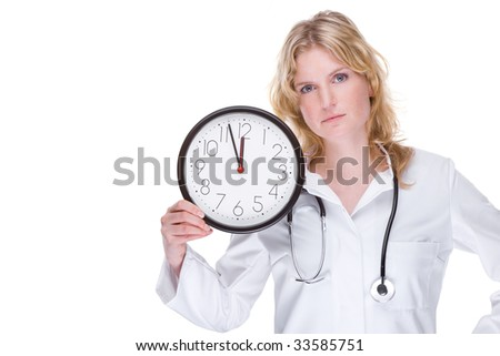 Full isolated portrait of a beautiful caucasian doctor with a clock - stock photo