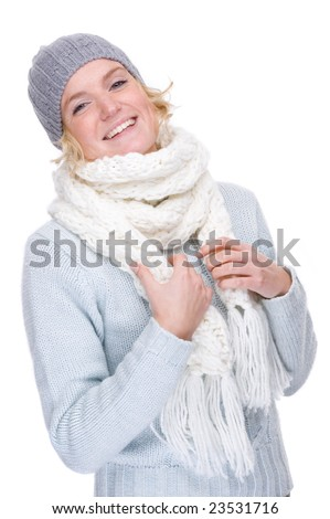 Full isolated portrait of a beautiful  caucasian smiling woman with muffler and cap - stock photo