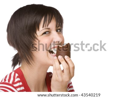 Full isolated portrait of a beautiful caucasian woman eating some sweets - stock photo