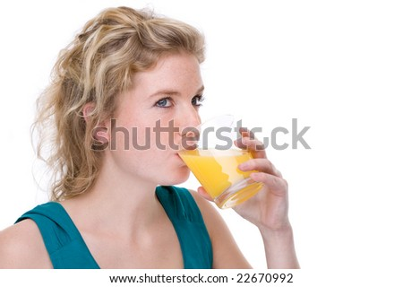 Full isolated portrait of a beautiful  caucasian woman with a glass of orange juice - stock photo