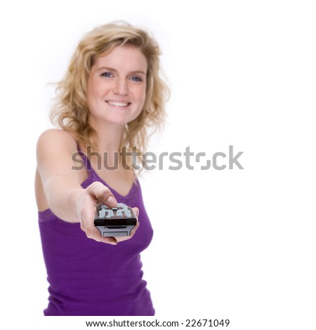 Full isolated portrait of a beautiful  caucasian woman with a remote control - stock photo