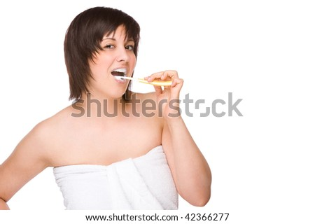 Full isolated portrait of a beautiful caucasian woman with a toothbrush - stock photo