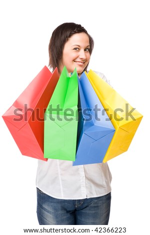 Full isolated portrait of a beautiful caucasian woman with some shopping bags - stock photo