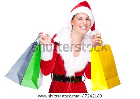 Full isolated studio picture from a beautiful woman in christmas dress with shopping bags