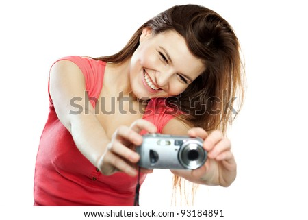 Full isolated studio picture from a young and beautiful woman with camera - stock photo