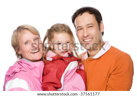 Full isolated studio picture from a young couple with her daughter