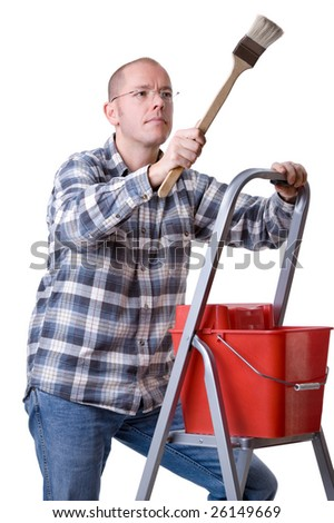 Full isolated studio picture from a young craftsman on a ladder with a brush - stock photo
