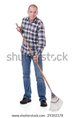 Full isolated studio picture from a young  gardener with a rake - stock photo