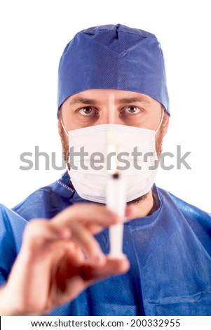 Full isolated studio picture from a young male doctor with syringe in his hand. Selective focus over the face.
