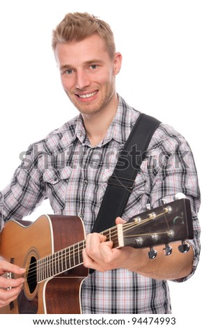 Full isolated studio picture from a young man with guitar - stock photo
