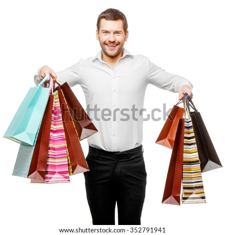 Full isolated studio picture from a young man with shopping bags - stock photo