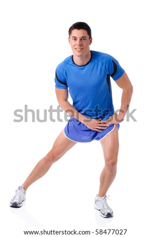 Full isolated studio picture from a young sports man - stock photo