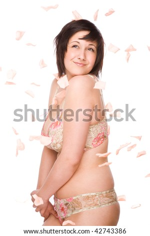 Full isolated studio picture from a young woman with falling flowers - stock photo