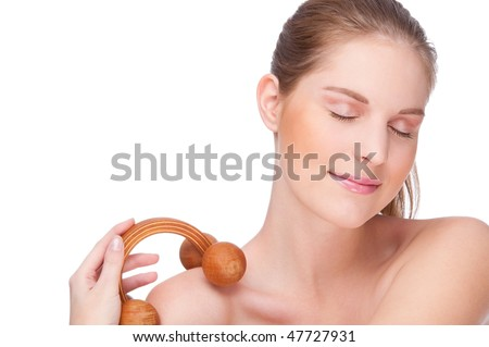 Full isolated studio picture from a young woman with massage roller