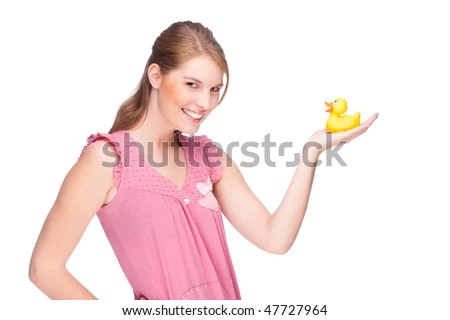 Full isolated studio picture from a young woman with yellow rubber duck - stock photo