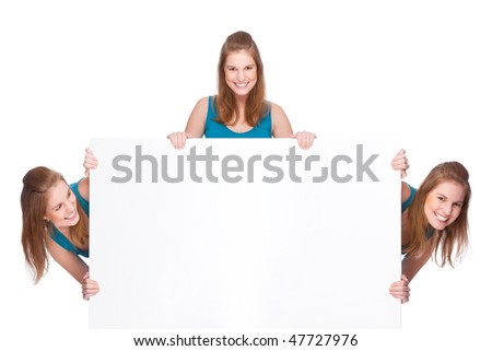 Full isolated studio picture from three young women with white copyspace sign (banner)
