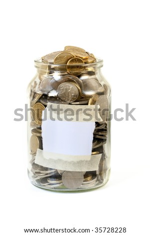 Full jar of Australian coins, with blank label ready for your message. - stock photo