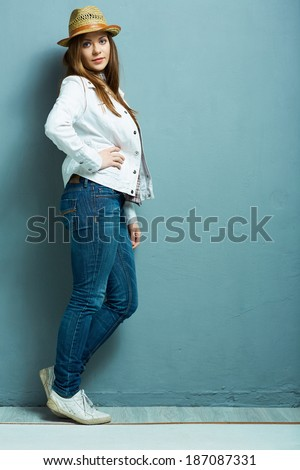 Full leg fashion portrait. American country style. Young model. Casual style.
