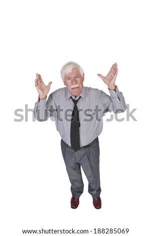full lenght old man with open hands looking up at the camera  - stock photo