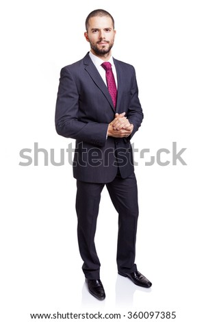 Full lenght portrait of a serious businessman, isolated on white background - stock photo