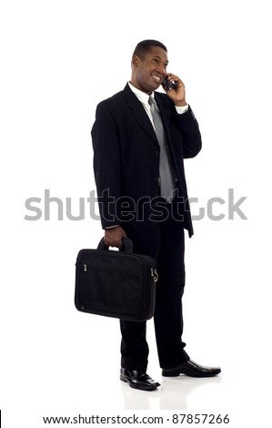 Full length a happy black businessman talking on the mobile phone isolated over white background - stock photo
