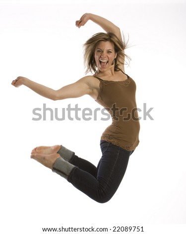 Full length action view of teenage girl jumping in air. White background.