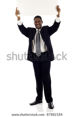 Full length African American business man holding a sign above his head isolated over white background