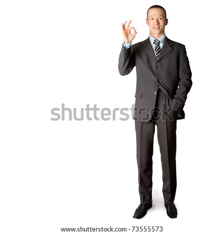 full length asian business male in suit shows OK - stock photo